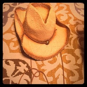 Straw cowboy style hat with drawstring